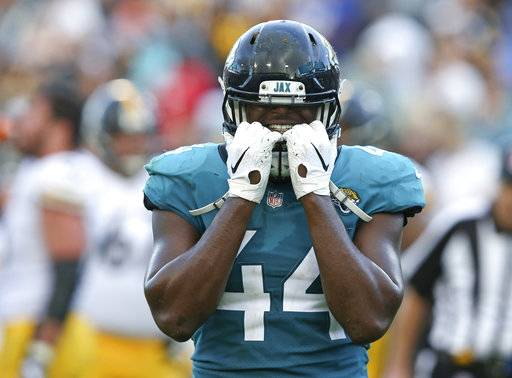 Jacksonville Jaguars middle linebacker Myles Jack (44) reacts after Pittsburgh Steelers quarterback Ben Roethlisberger scored a go-ahead touchdown during the final seconds of an NFL football game, Sunday, Nov. 18, 2018, in Jacksonville, Fla. (AP Photo/Gary McCullough)