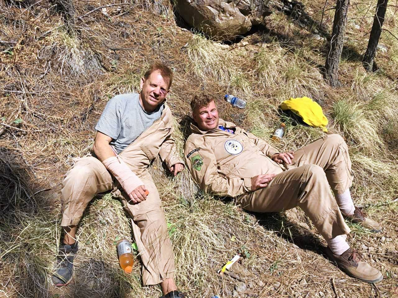 Ken Franzese of Barrington, left, and Ron Carlson of Hawthorn Woods are pictured May 7 after they were rescued by a forest land management crew in Fort Apache Indian Reservation in Arizona. Both were injured jumping with parachutes from their disabled plane the day before.