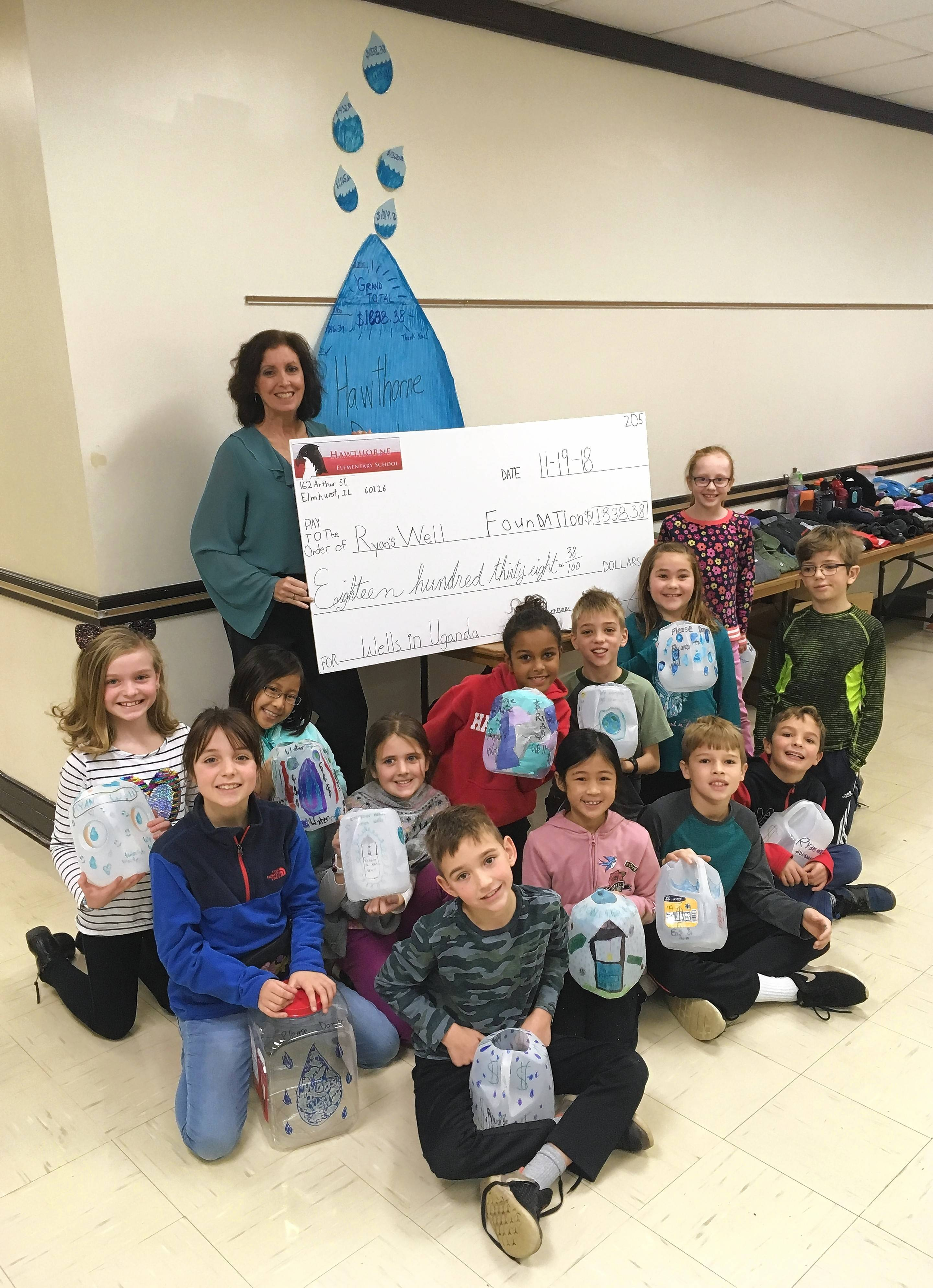 "Members of the third-grade ""LA REACH"" class at Hawthorne Elementary School in Elmhurst participate in a fundraiser to benefit Ryan's Well Foundation."