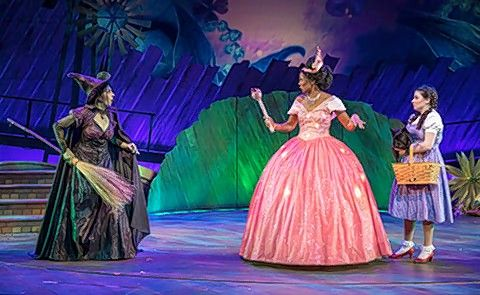 "Dorothy (Elizabeth Stenholt), right, meets Good Witch of the North Glinda (Harriet Nzinga Plumpp) and Wicked Witch of the West (Caron Buinis) in Paramount Theatre's ""The Wizard of Oz."""