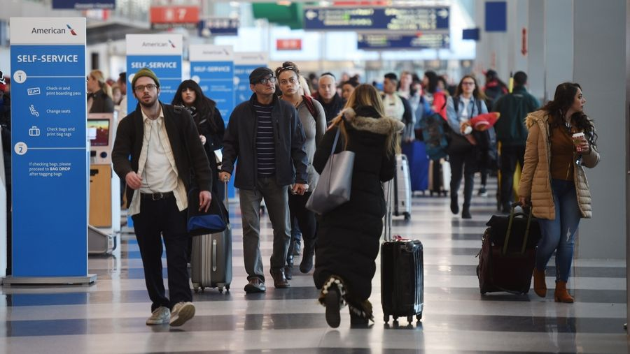 Thanksgiving travelers make their way through Terminal 3 Wednesday at O'Hare International Airport.