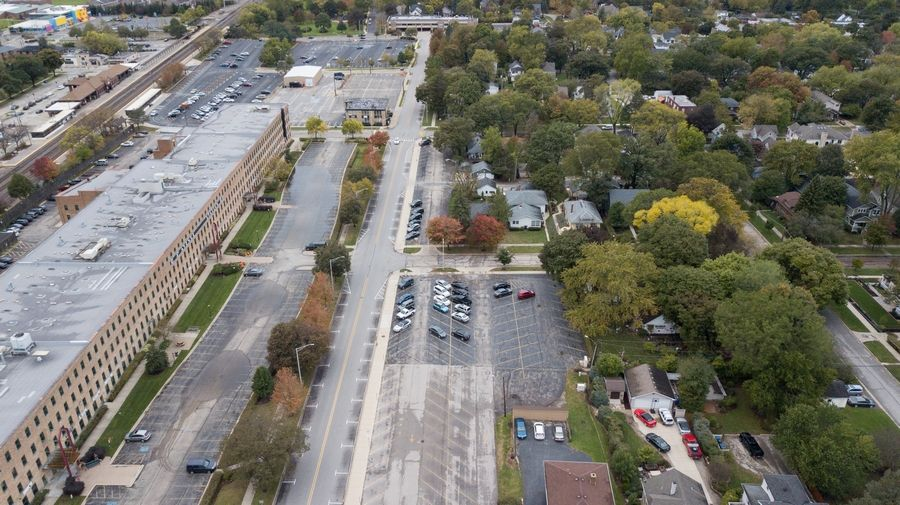 Whether to add up to 400 commuter parking spaces near the 5th Avenue area and the Naperville Metra station is something the city council is weighing against the potential added traffic.