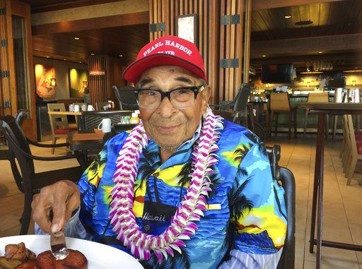 FILE - In this Dec. 5, 2016, file photo, Ray Chavez, a Pearl Harbor survivor from Poway, Calif., poses for a photo as he was eating breakfast in Honolulu. Chavez was out on a minesweeper, the USS Condor, in the early hours before the attack. The oldest U.S. military survivor of the Dec. 7, 1941, attack on Pearl Harbor has died at age 106. Chavez's daughter, Kathleen Chavez, of Poway, Calif., tells The Associated Press her father died in his sleep Wednesday, Nov. 21, 2018.