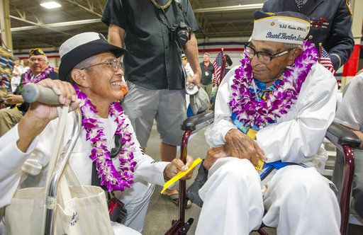 FILE - In this Dec. 7, 2016, file photo, Kathleen Chavez, left, talks with her father Ray Chavez, right, age 104, of the USS Condor, the oldest living survivor from the Pearl Harbor attacks along with the remaining living survivors of the USS Arizona gathered at the World War II Valor in the Pacific National Monument at Joint Base Pearl Harbor-Hickam in Honolulu. Ray Chavez, the oldest U.S. military survivor of the Dec. 7, 1941, attack on Pearl Harbor that plunged the United States into World War II has died at age 106. Chavez's daughter, Kathleen Chavez of Poway, Calif., tells The Associated Press her father died in his sleep Wednesday, Nov. 21, 2018.