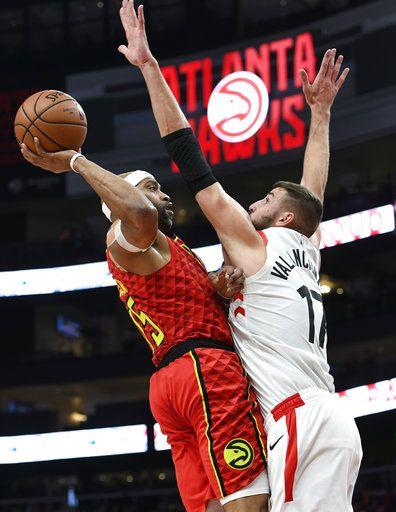 f9b98e95e2d Atlanta Hawks forward Vince Carter shoots over Toronto Raptors center Jonas  Valanciunas during the first half