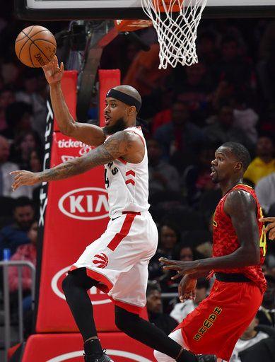 64363bd8e6d Toronto Raptors guard Lorenzo Brown, left, passes the ball as Atlanta Hawks  center Dewayne