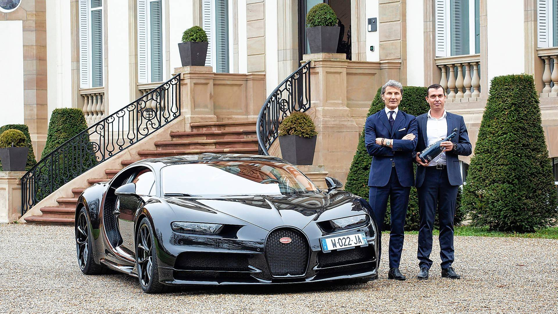 Bugatti CEO Stephan Winkelmann, left, and Champagne Carbon CEO Alexandre Mea shake hands after signing a contract at the Bugatti headquarters in France.