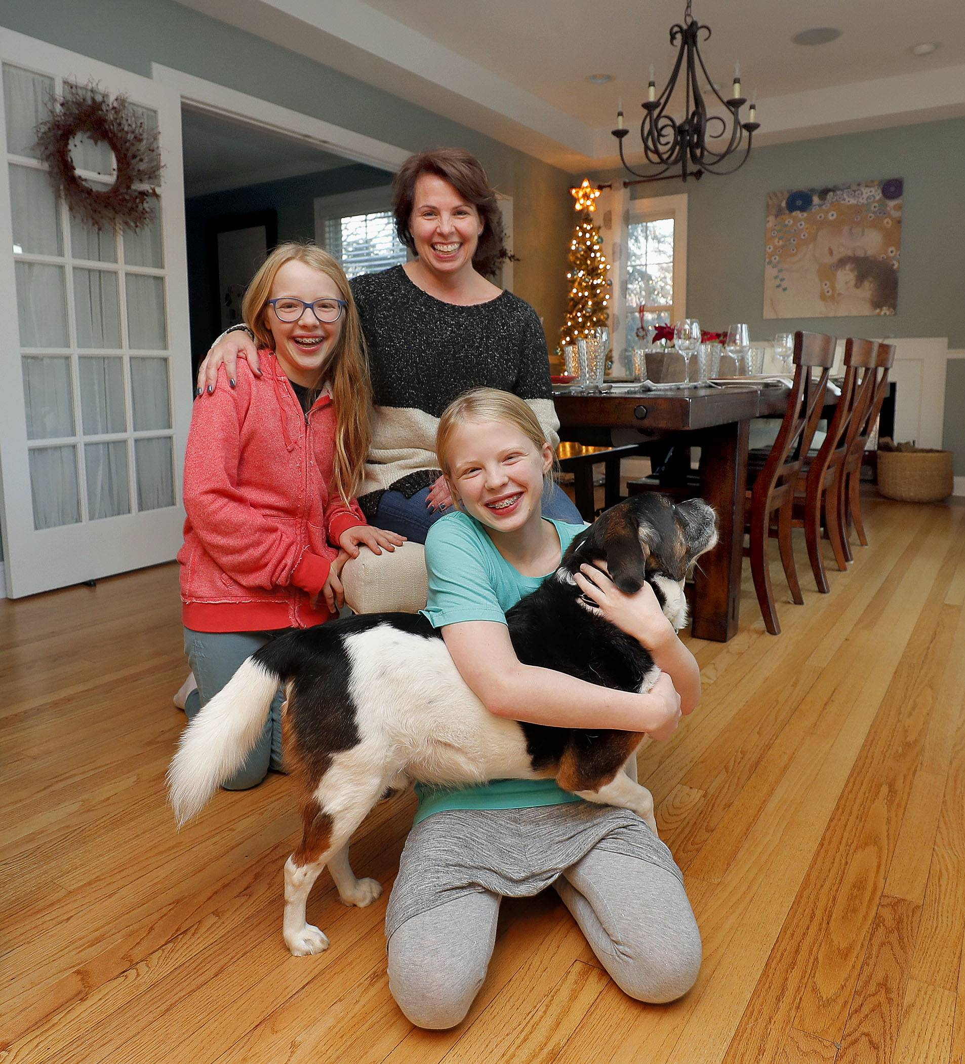 The Meier family, from left, Fiona, 13, Barb, Amelia, 11, and dog Jake, will open their house for the annual Mount Prospect Holiday Housewalk Friday, Nov. 30.