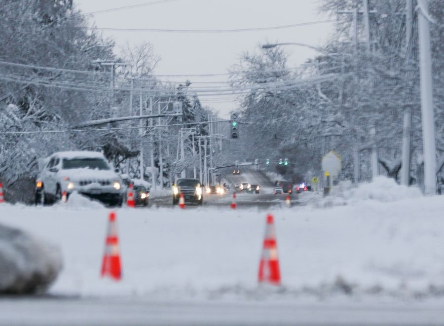 Part of Roselle Road in Roselle was blocked off Monday morning due to power lines down after the snowstorm.