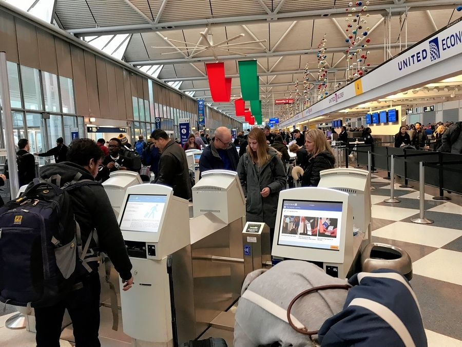 Travelers faced long lines Sunday at O'Hare International Airport, as a combination of busy holiday travel and winter weather caused problems. More than 300 flights had been canceled by 1:45 p.m.