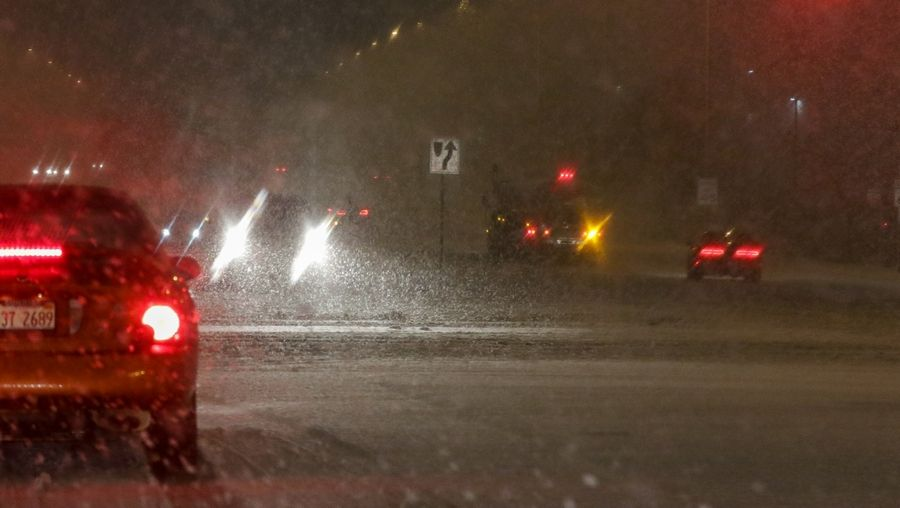 North Avenue in Carol Stream had low visibility during snowfall on Sunday.