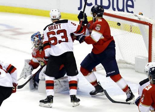 ... puck as Buffalo  new arrivals 53ffd 384bd New Jersey Devils left wing  Jesper Bratt (63) scores a ... 45d078653
