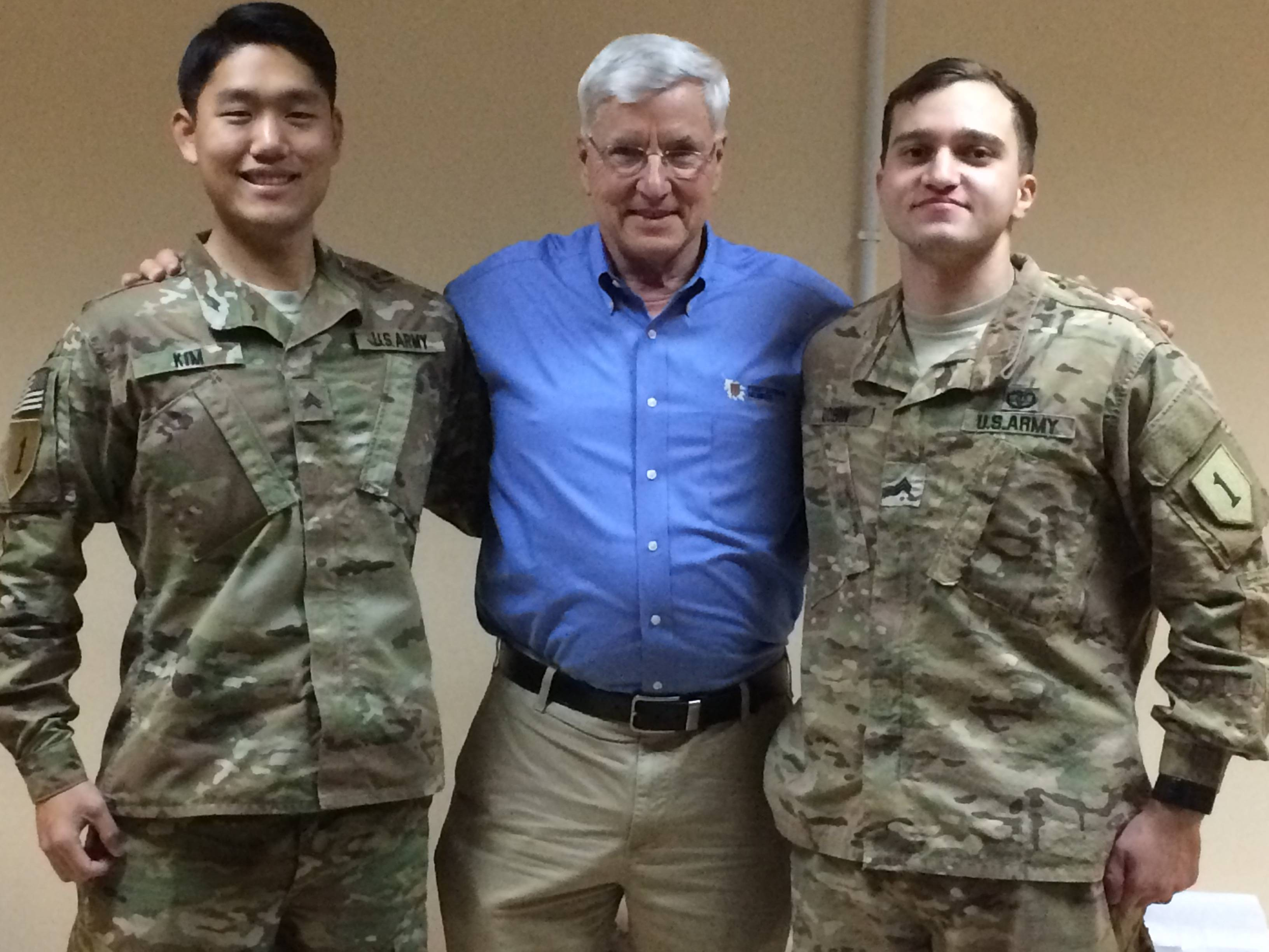 First Division Museum Director Paul Herbert met with Sgts. Christian Kim, left, of Deerfield and Vladislov Dobin of Lake Zurich.