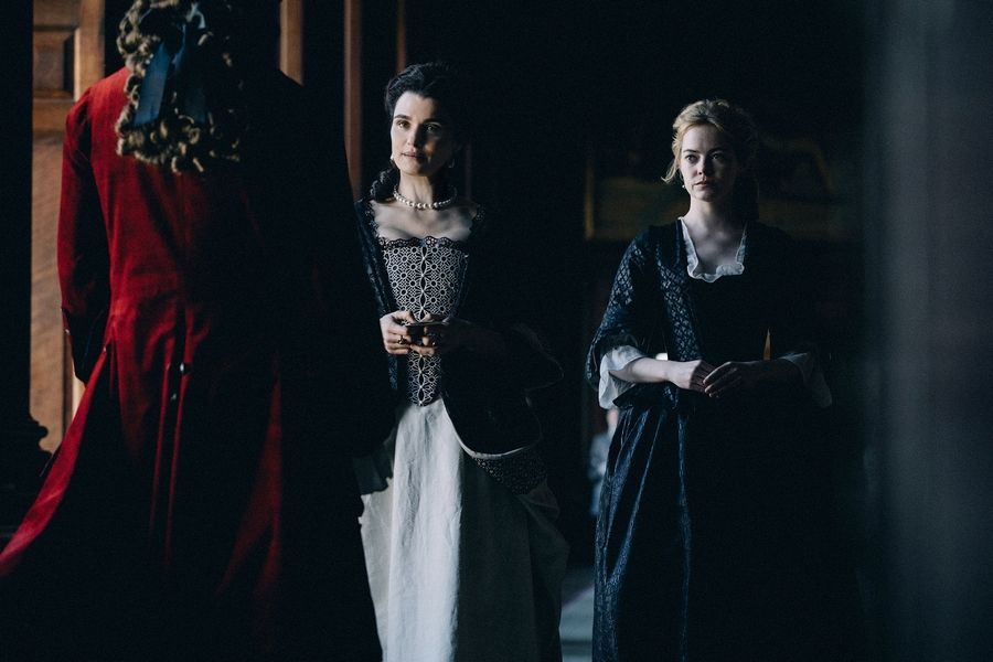 "Lady Sarah (Rachel Weisz), left, finds her status with the queen threatened by the arrival of her cousin (Emma Stone) in ""The Favourite."""