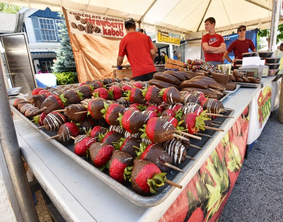 Strawberry kebabs were piled up and waiting for customers at the Strawberry Patch booth at this year's Long Grove Strawberry Fest. Long Grove village board members Tuesday agreed keep an 11 p.m. end time for six annual downtown festivals despite several residents expressing concern about the late hour through a petition they signed.