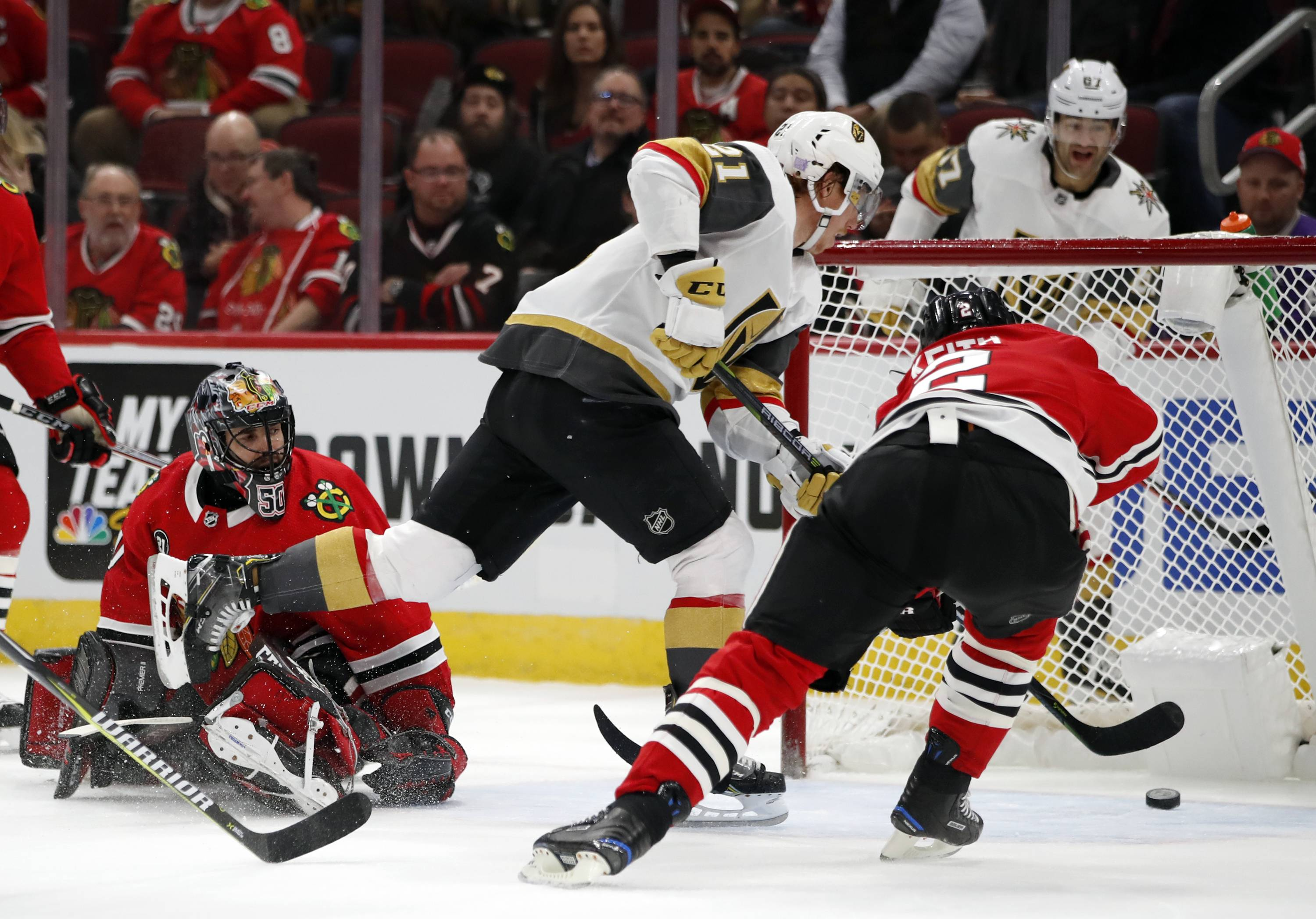 Vegas Golden Knights center Cody Eakin (21) scores a goal past Chicago Blackhawks goaltender Corey Crawford (50) and defenseman Duncan Keith (2) during the first period of an NHL hockey game Tuesday, Nov. 27, 2018, in Chicago.