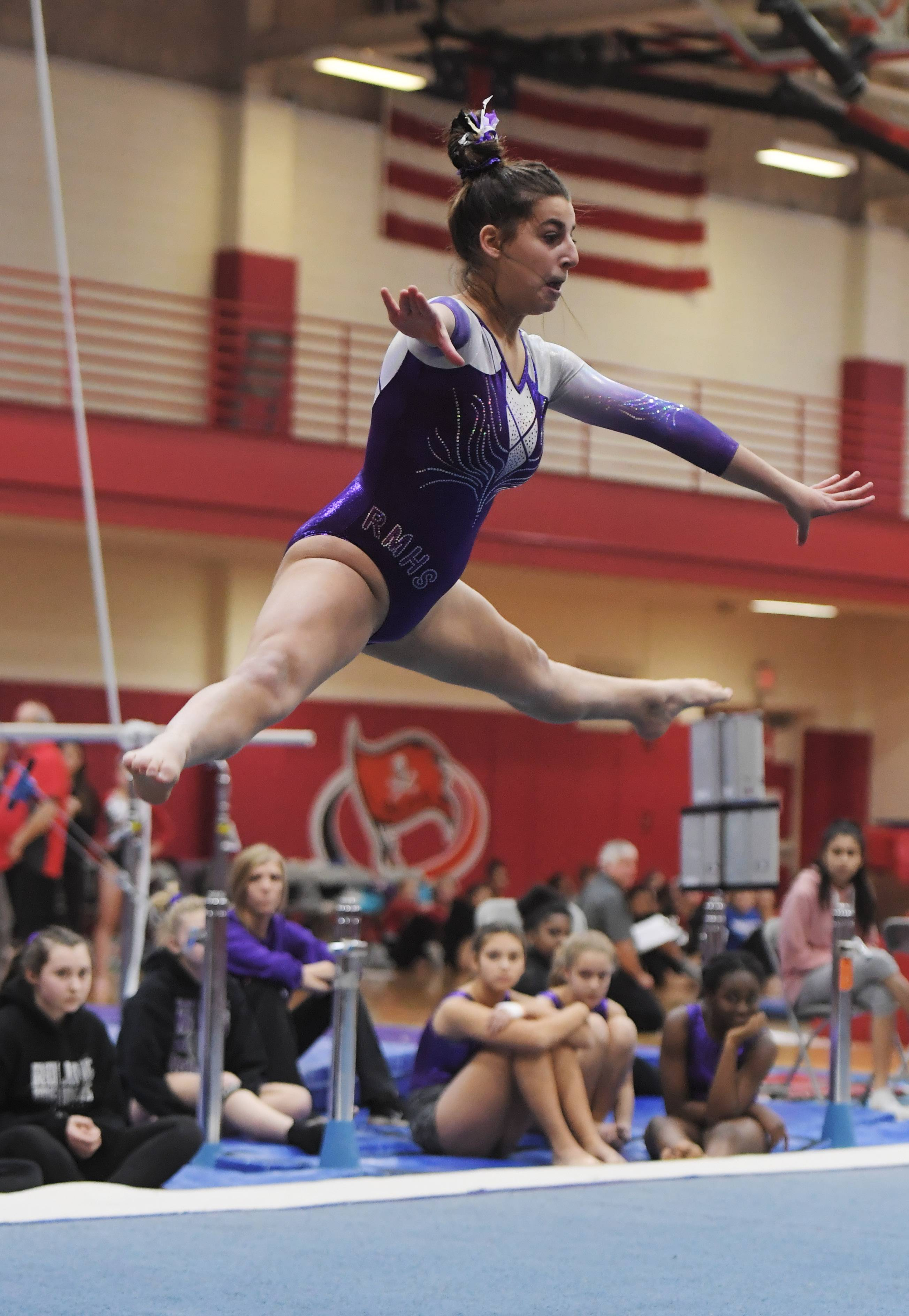 Rolling Meadows' Roula Zervos competes on the floor exercise during Wednesday's meet at Palatine.
