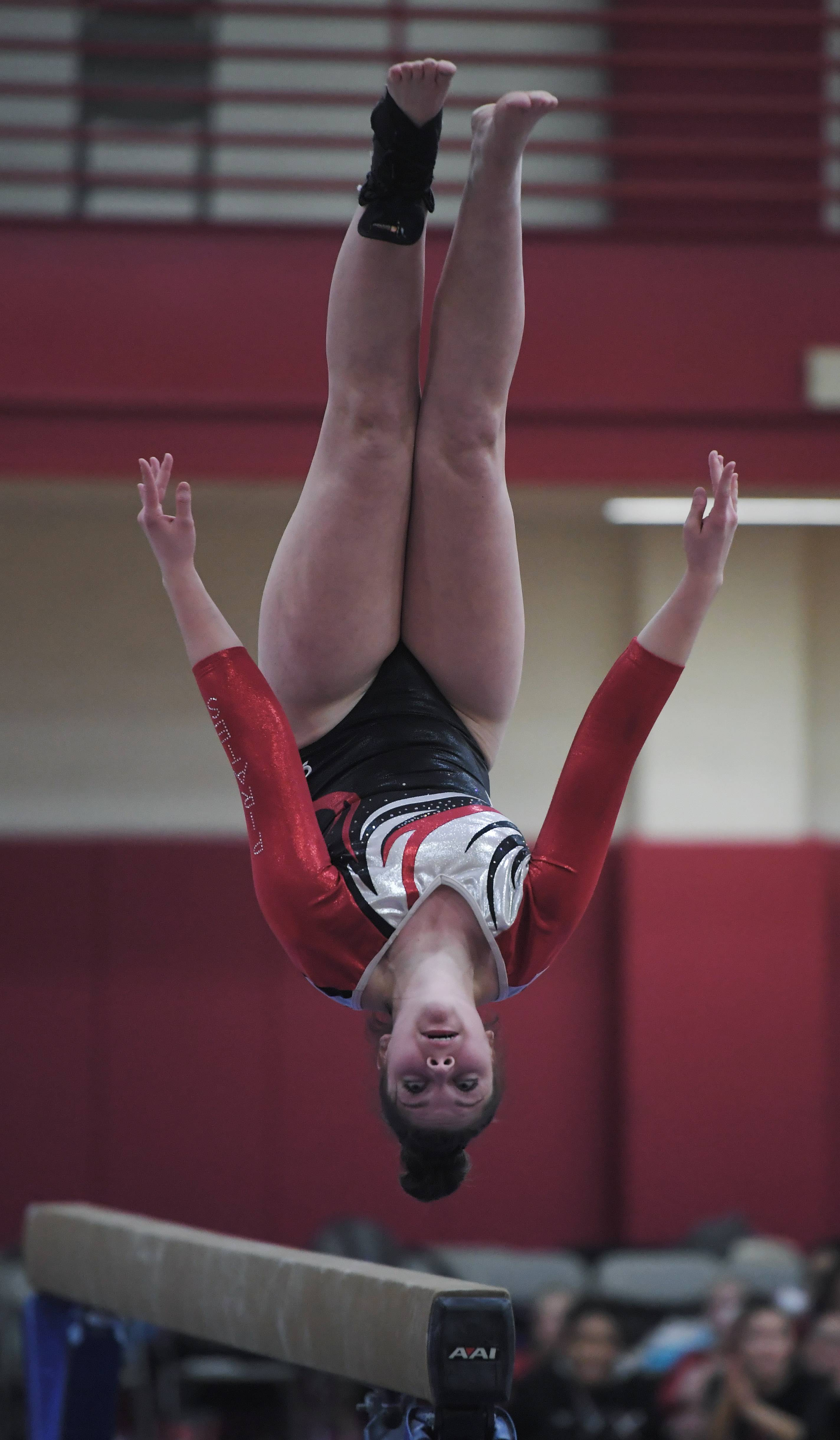 Palatine's Kristen Ure dismounts from the balance beam during Wednesday's home meet with Rolling Meadows.