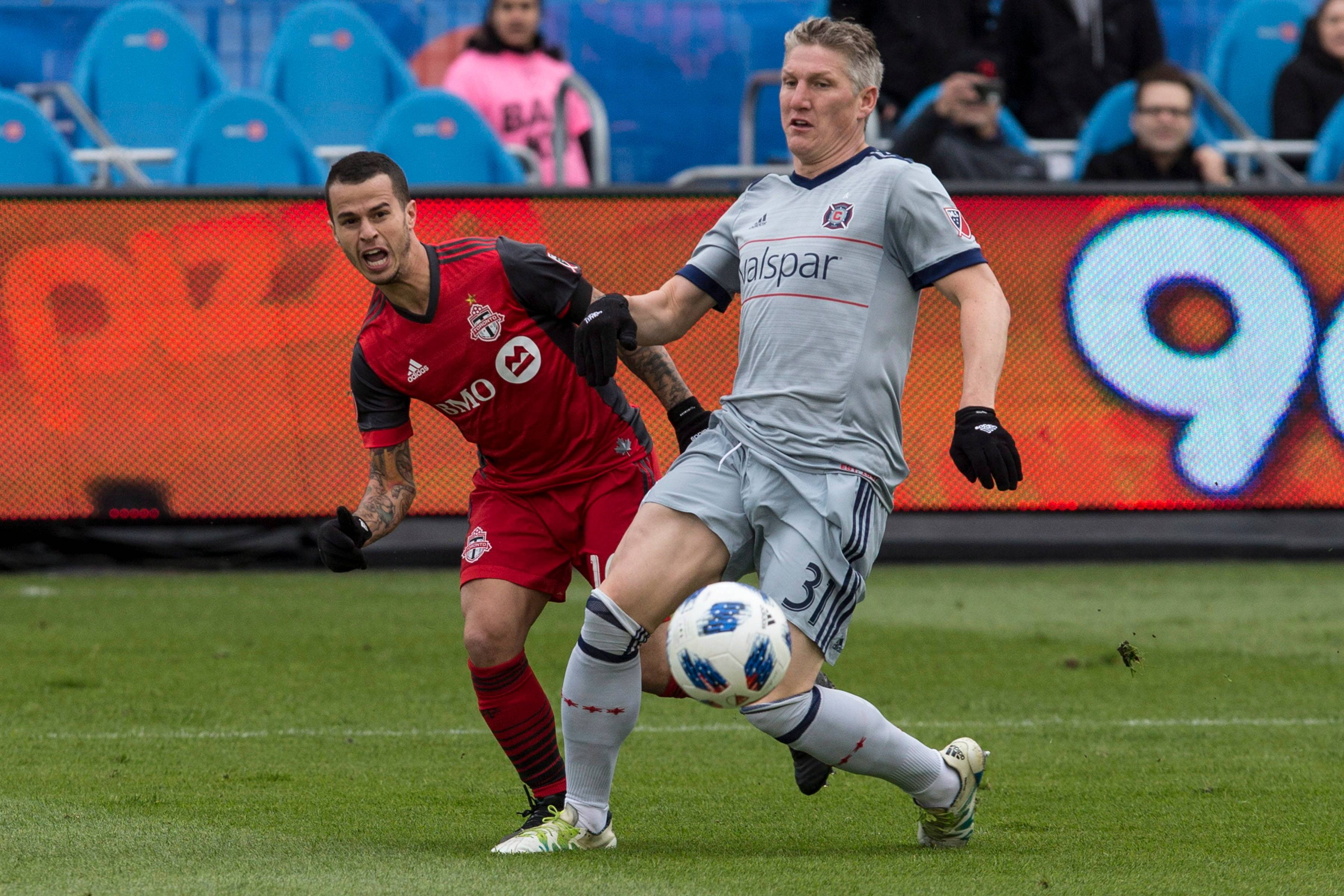 Toronto FC's Sebastian Giovinco (left) moves the ball past Chicago Fire's Bastian Schweinsteiger during an April match in Toronto.