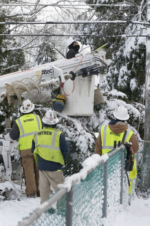 ComEd officials said all of the power outages from Sunday's storm were fixed by nightfall Thursday. This crew was working Wednesday in Arlington Heights, one of the hardest-hit towns.