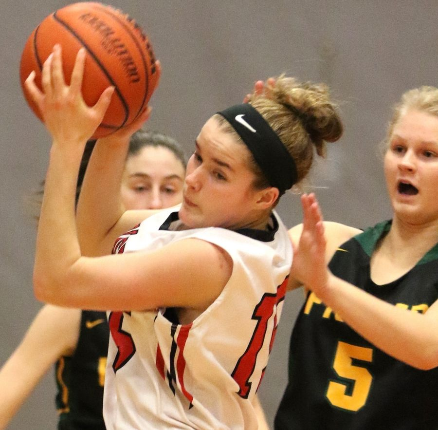 Barrington's Anna Mae King, left, moves the ball past Fremd's Ruthie Montella during varsity girls basketball in Barrington on Friday night.