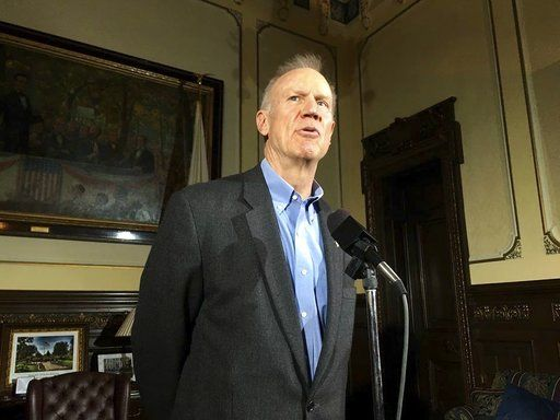 Illinois Gov. Bruce Rauner speaks at a news conference on Thursday, Nov. 29, 2018 in Springfield, Ill. Rauner wants to pressure Airbnb into reversing its decision barring lodging listings in the disputed West Bank. The Republican issued a letter Thursday to the Illinois Investment Policy Board. He's requesting an investigation into whether the online lodging marketplace is violating Illinois' ban on aiding the Boycott, Divestment or Sanction movement against Israel's treatment of Palestinians.