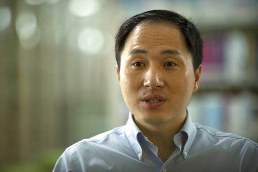 In this Oct. 10, 2018, photo, scientist He Jiankui speaks during an interview in Shenzhen in southern China's Guandong province. China's government on Thursday, Nov. 29, 2018, ordered a halt to work by a medical team that claimed to have helped make the world's first gene-edited babies.