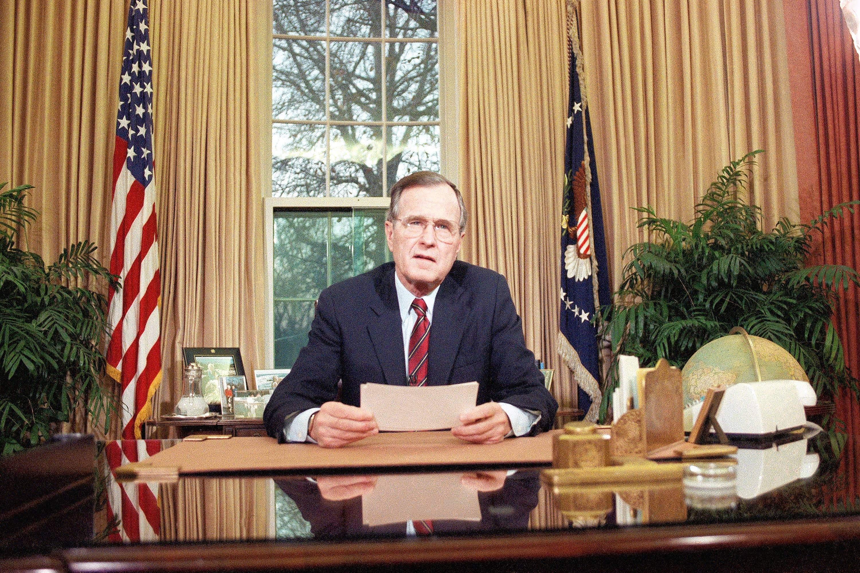 President Bush addresses the nation on television from the Oval Office in Washington on Dec. 20, 1989, as he explains his decision to deploy American troops to Panama. Bush said some Americans were among the death and that Panamanian leader Gen. Manuel Antonio Noriega was in hiding.