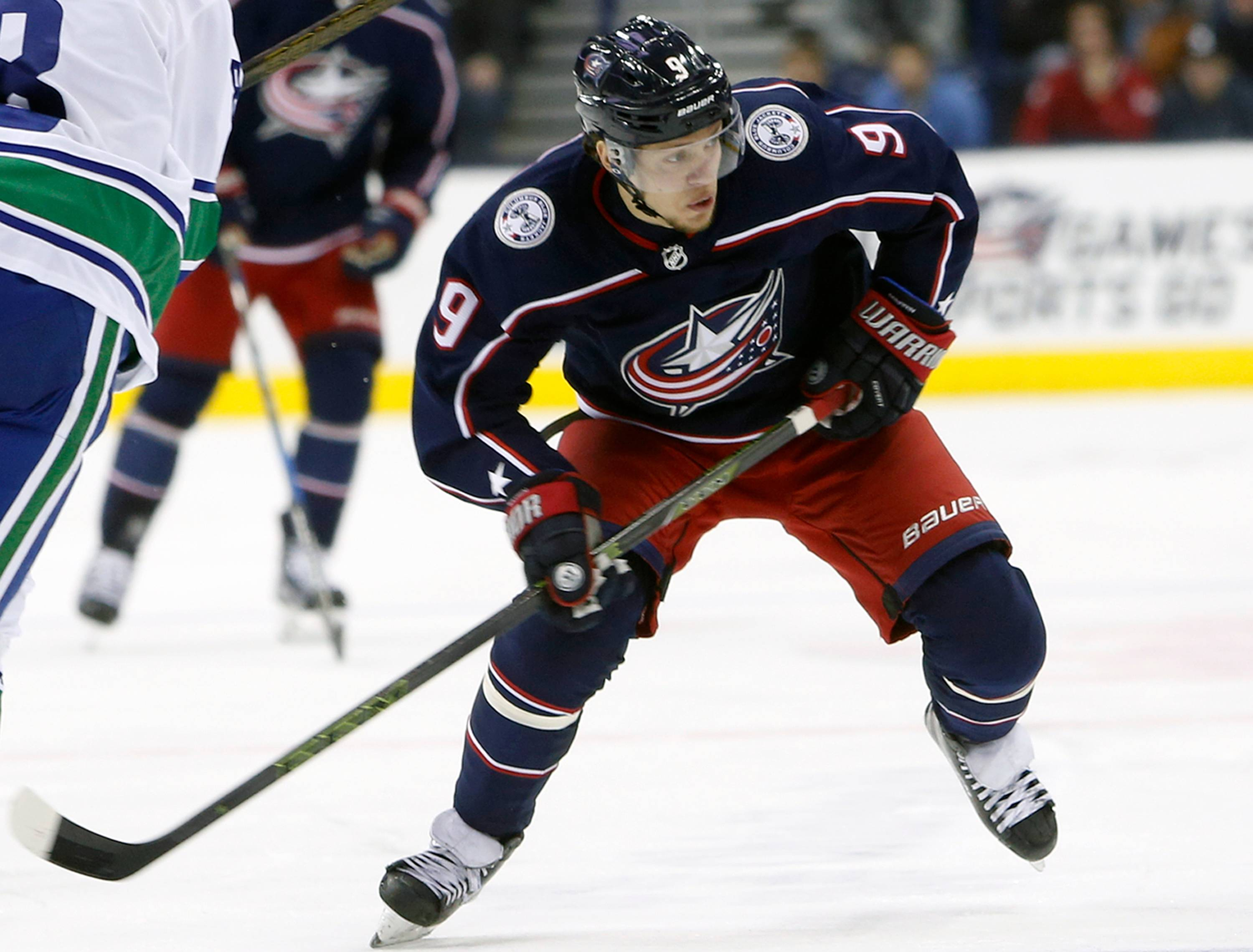 Columbus Blue Jackets' Artemi Panarin, of Russia, plays against the Vancouver Canucks during an NHL hockey game in Columbus, Ohio.