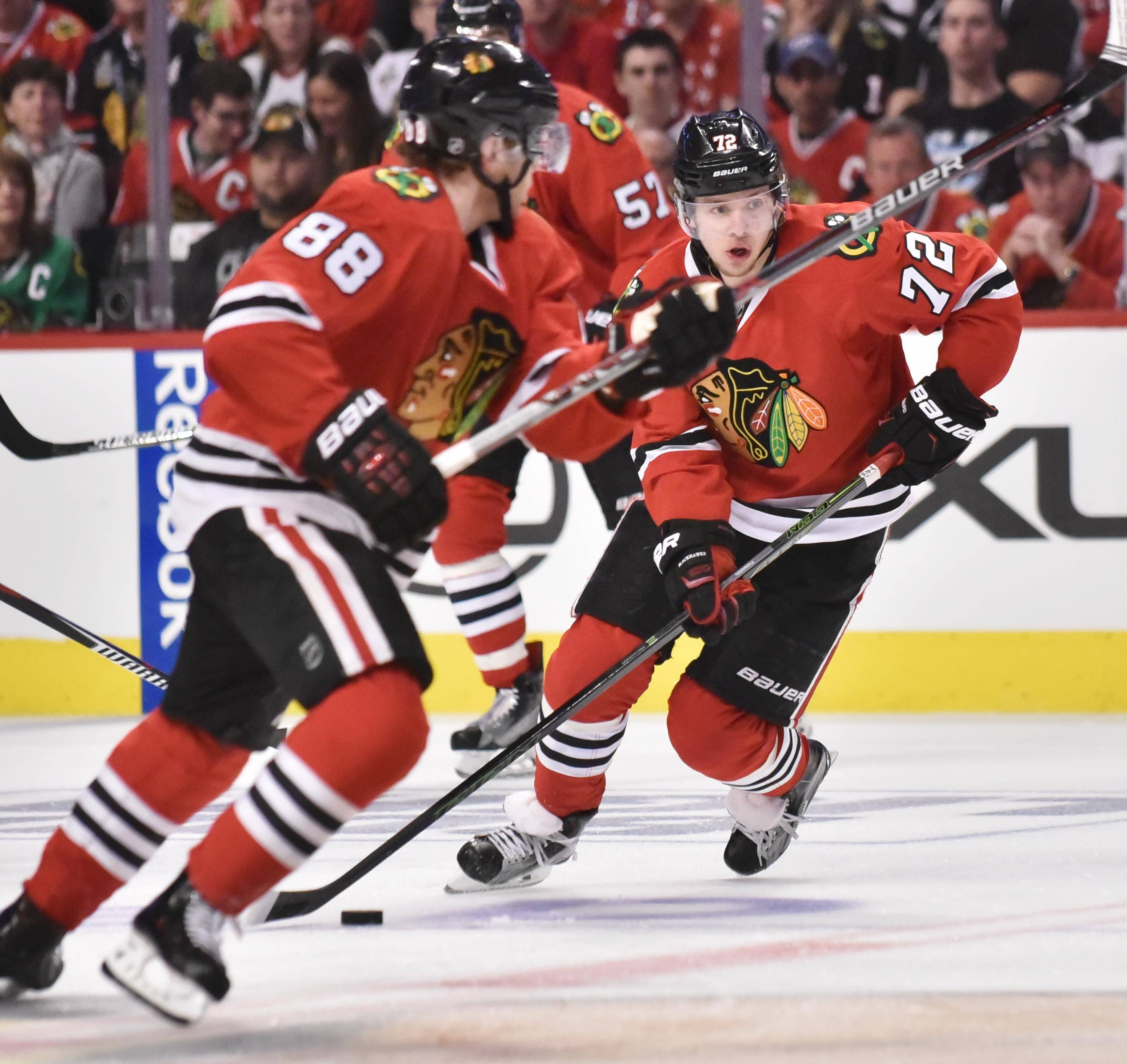 Chicago Blackhawks left wing Artemi Panarin and right wing Patrick Kane skate up ice against the St. Louis Blues.