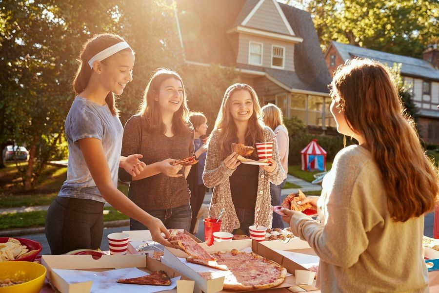 Organizing a block party or neighborhood service project is one way to get to know your neighbors.