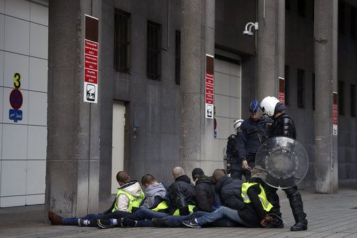 Protestors are arrested during a protest of the yellow jackets in Brussels, Friday, Nov. 30, 2018. The demonstrators are protesting against rising fuel prices.