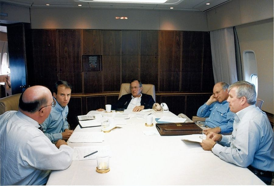 Ed Murnane, right, in conference with President George H.W. Bush on Air Force One.