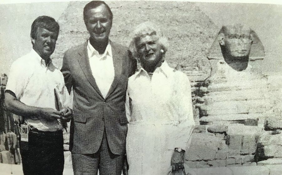 Ed Murnane, who served the White House as an advance coordinator for many presidential trips, poses for a photo with President and Mrs. Bush in front of the pyramids in Egypt.
