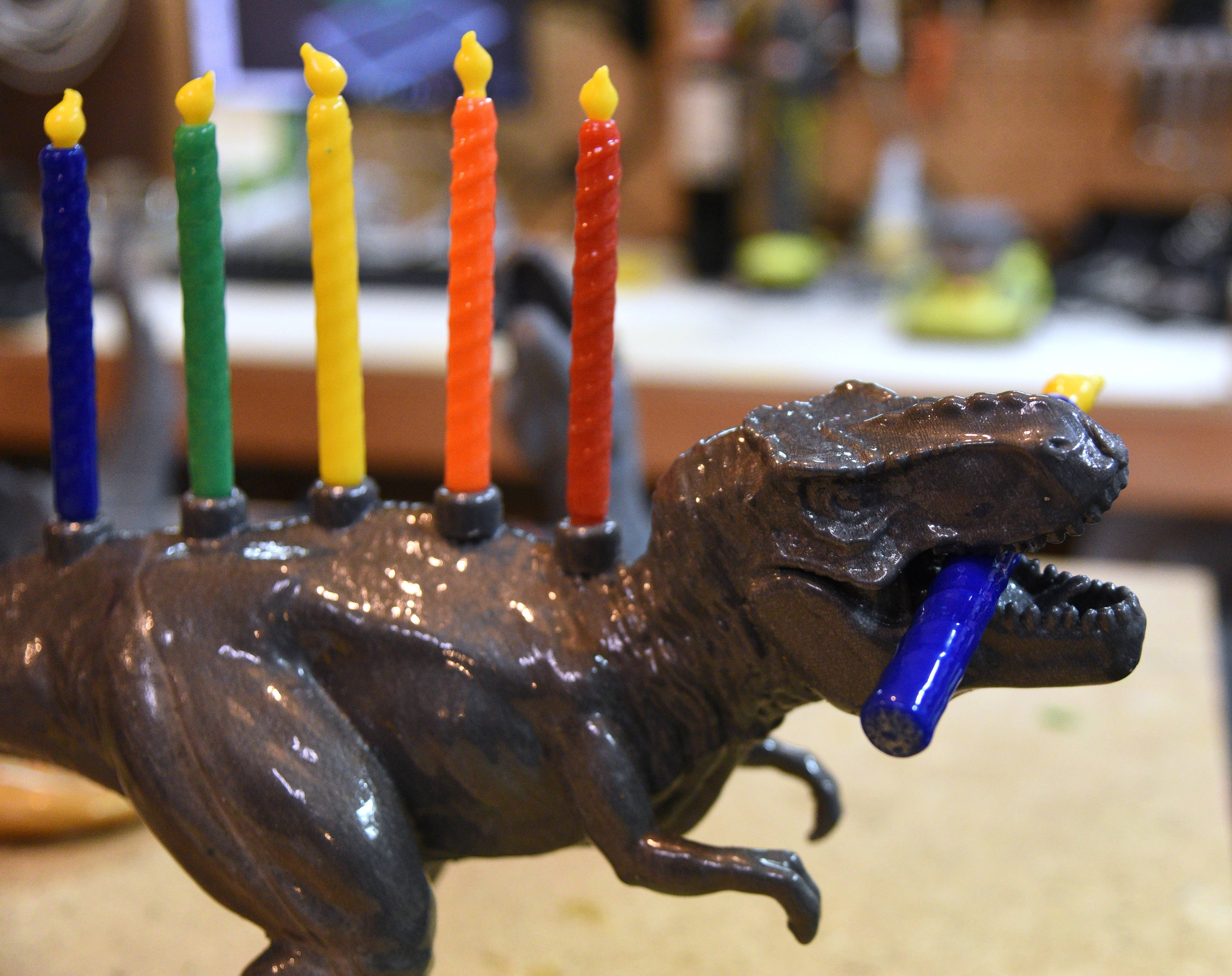 A dinosaur menorah is one of the 3-D printer products Mundelein resident Lauren Jackson makes for her business Monka! Goods.