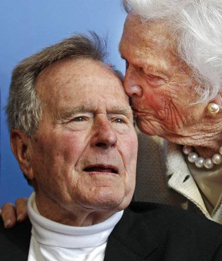 FILE - In this June 12, 2012 file photo, former President George H.W. Bush, and his wife, former first lady Barbara Bush, arrive for the premiere of HBO's new documentary on his life near the family compound in Kennebunkport, Maine. Bush has died at age 94. Family spokesman Jim McGrath says Bush died shortly after 10 p.m. Friday, Nov. 30, 2018, about eight months after the death of his wife, Barbara Bush.
