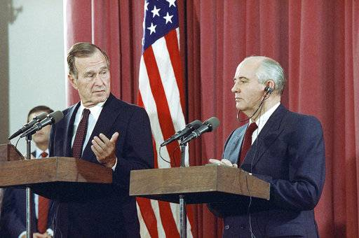 FILE - In this Oct. 29, 1991, file photo, President George H.W. Bush gestures during a joint news conference with Soviet President Mikhail Gorbachev,  at the Soviet Embassy in Madrid. Bush died at the age of 94 on Friday, Nov. 30, 2018, about eight months after the death of his wife, Barbara Bush.