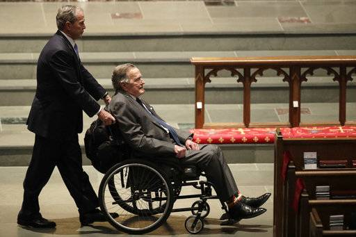 FILE - In this April 21, 2018 file photo, former Presidents George W. Bush, left, and George H.W. Bush arrive at St. Martin's Episcopal Church for a funeral service for former first lady Barbara Bush,  in Houston. Bush has died at age 94. Family spokesman Jim McGrath says Bush died shortly after 10 p.m. Friday, Nov. 30, 2018, about eight months after the death of his wife, Barbara Bush.