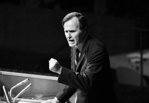 "FILE - In this Oct. 18, 1971, file photo, U.S. Ambassador George H.W. Bush gestures as he addresses the United Nations General Assembly during the China debate. He denied the U.S. formula was either a ""Two Chinas"" or a ""One China and one Taiwan"" plan. Bush died at the age of 94 on Friday, Nov. 30, 2018, about eight months after the death of his wife, Barbara Bush."