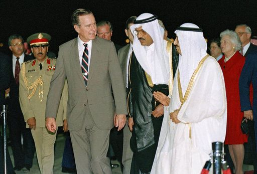 FILE - In this Nov. 21, 1990 file photo, President George H.W. Bush is greeted by King Fahd as he arrives in Saudi Arabia. At right is first lady Barbara Bush. At center is an interpreter. Bush died at the age of 94 on Friday, Nov. 30, 2018, about eight months after the death of his wife, Barbara Bush.