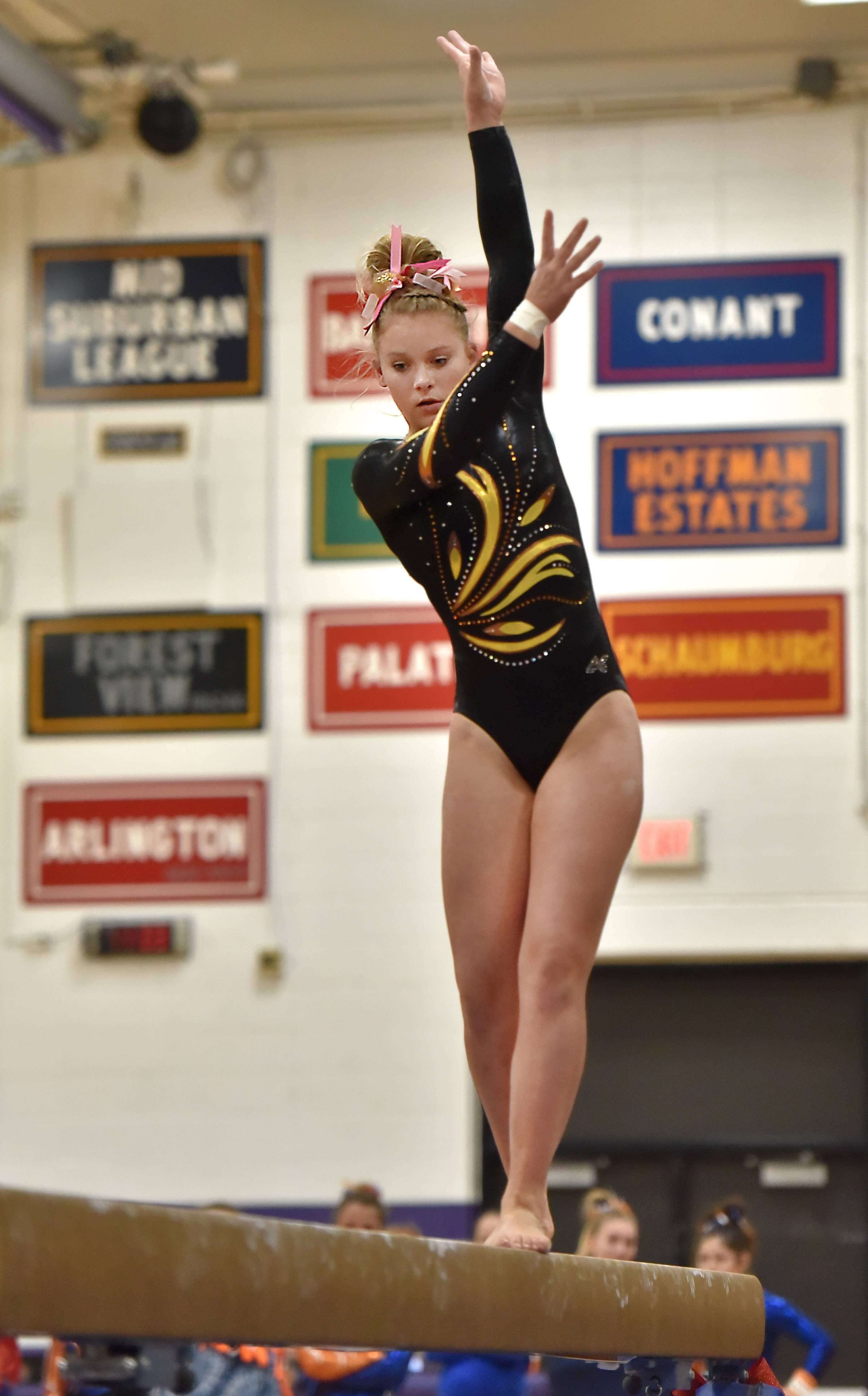 Carmel's Kyla Rapplean performs on the Balance Beam Saturday at the Rolling Meadows High School girls gymnastics Al Galatte Holiday Invitational.