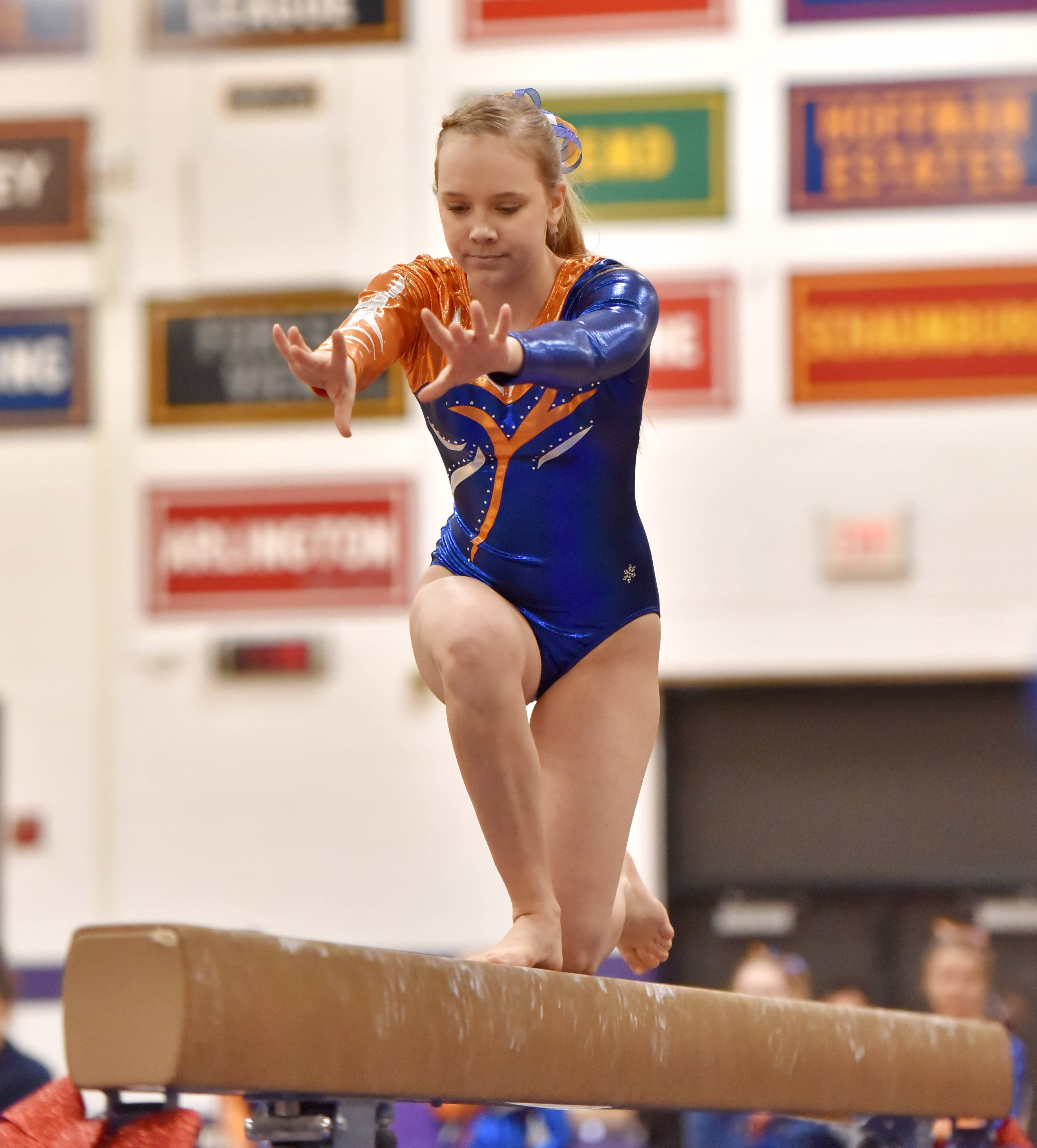 Buffalo Grove's Emma Fickett performs on the Balance Beam Saturday at the Rolling Meadows High School girls gymnastics Al Galatte Holiday Invitational.