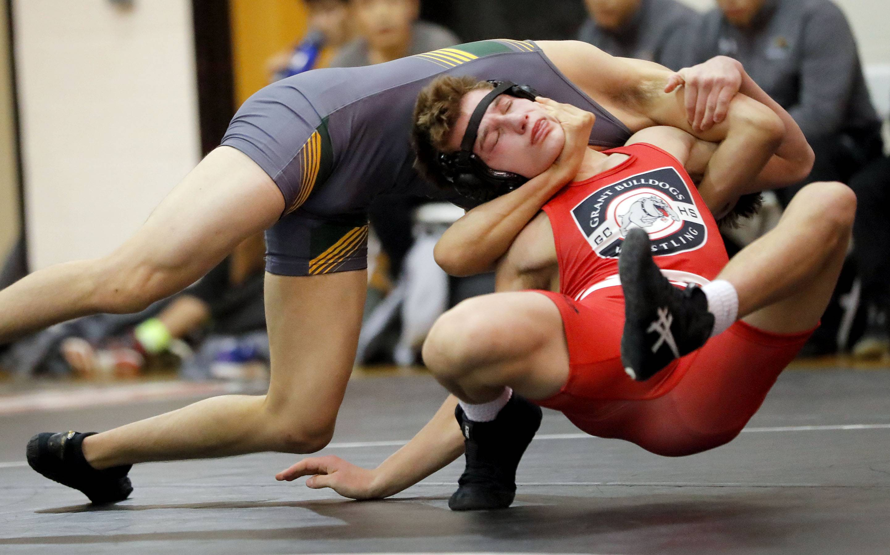 Stevenson's Jason Bickers, left, takes on Grant's Brett Riggs 145 pounds during their triple dual meet Saturday at Grant High School in Fox Lake.