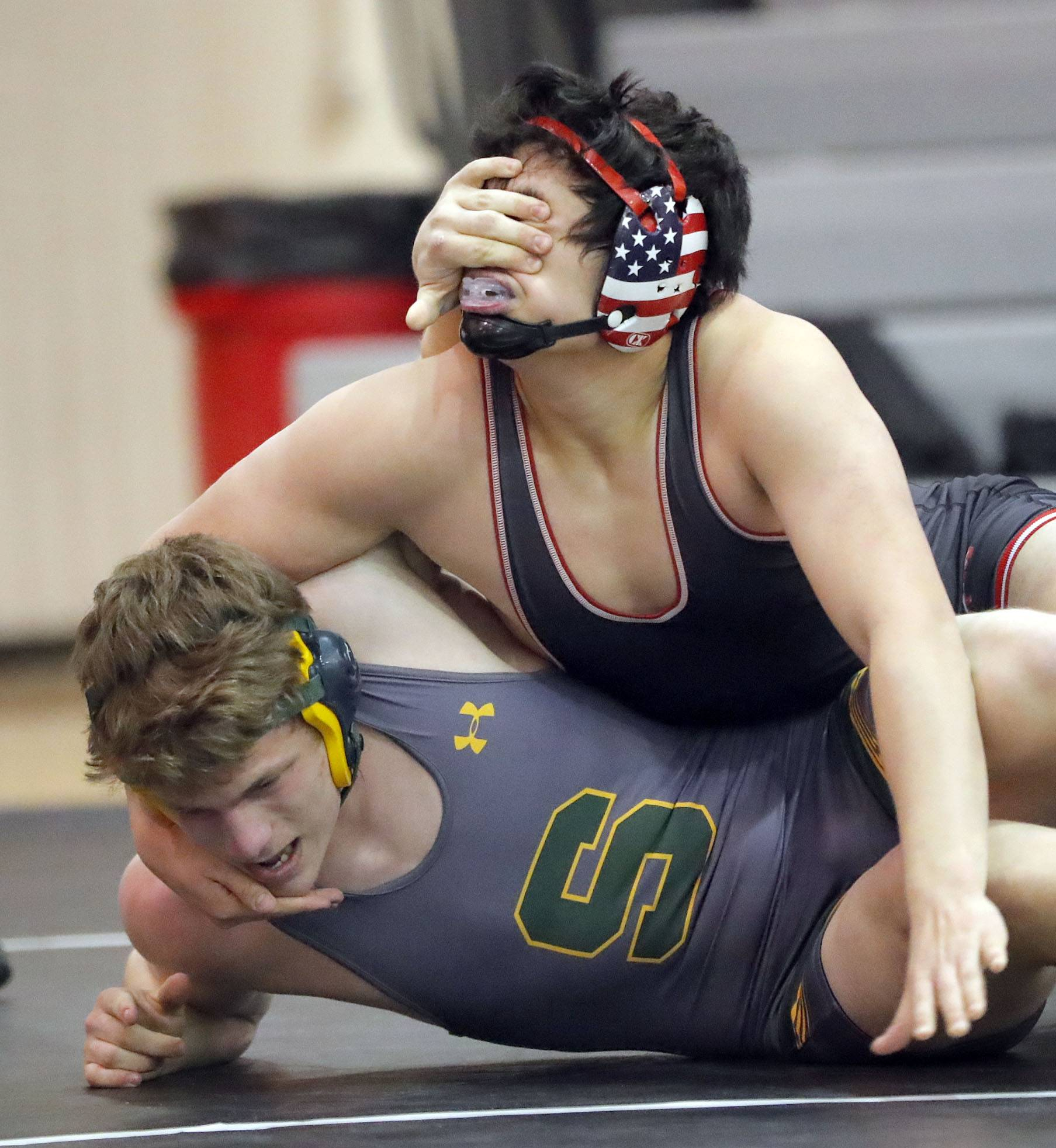 Stevenson's Michael Phelps goes cross face against Barrington's Jack Hartman, top, as they wrestle at 195 pounds during their triple dual meet Saturday at Grant High School in Fox Lake.