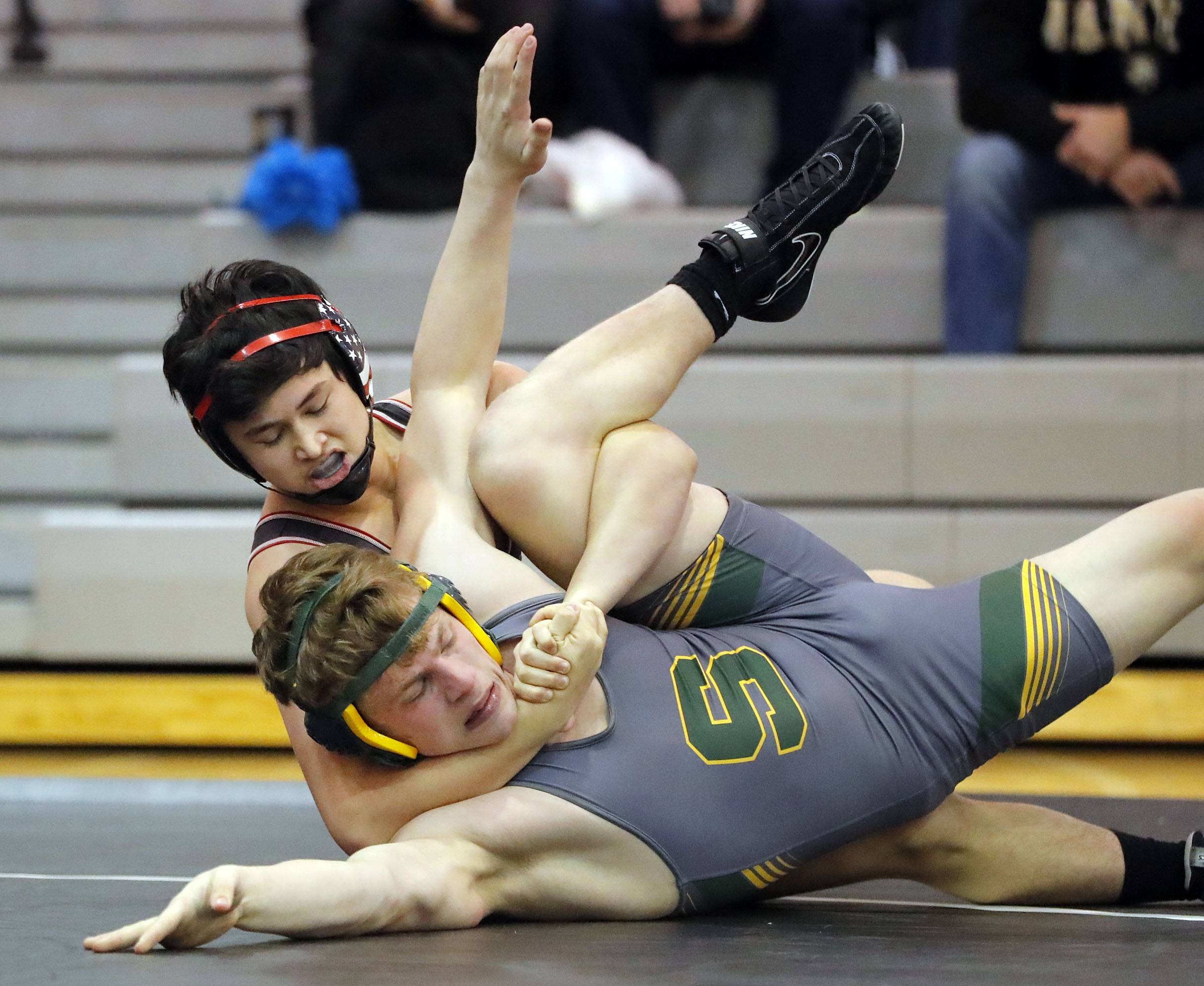Barrington's Jack Hartman, top, controls Stevenson's Michael Phelps as they wrestle at 195 pounds during their triple dual meet Saturday at Grant High School in Fox Lake.