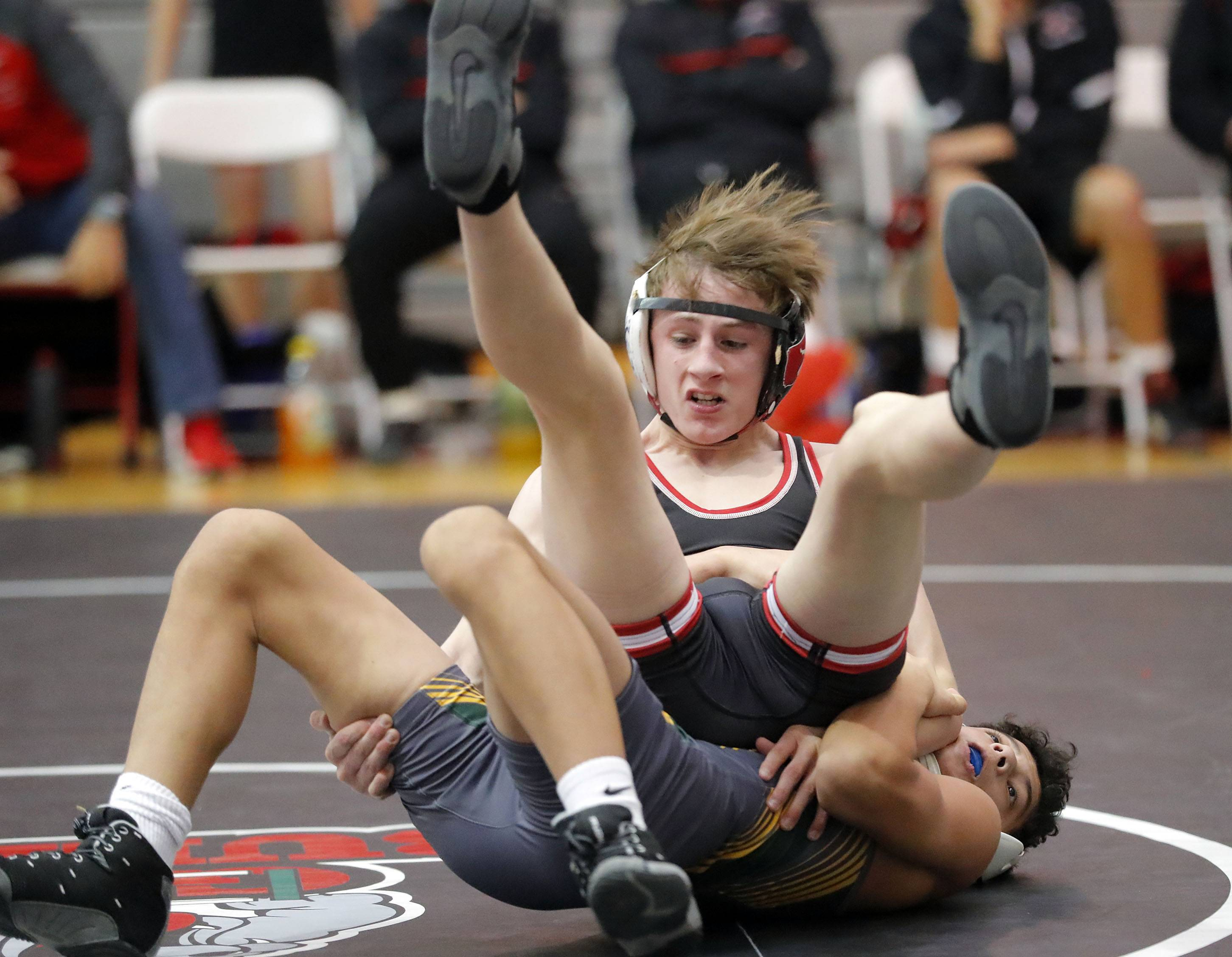 Barrington's Brian Beers, top and Stevenson's Cole Rhemrev wrestle at 106 pounds during their triple dual meet Saturday at Grant High School in Fox Lake.
