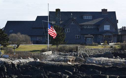 The American flag flies at half-mast at Walker's Point, the summer home of former President George H. W. Bush, Saturday, Dec. 1, 2018, in Kennebunkport, Maine. Bush died at the age of 94 on Friday, about eight months after the death of his wife, Barbara Bush.