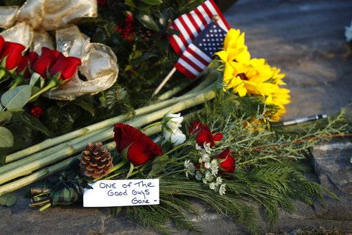 "Flowers and a note saying former President George H. W. Bush was ""one of the good guys,"" are seen at a makeshift memorial across from Walker's Point, the Bush's summer home, Saturday, Dec. 1, 2018, in Kennebunkport, Maine. Bush died at the age of 94 on Friday, about eight months after the death of his wife, Barbara Bush."