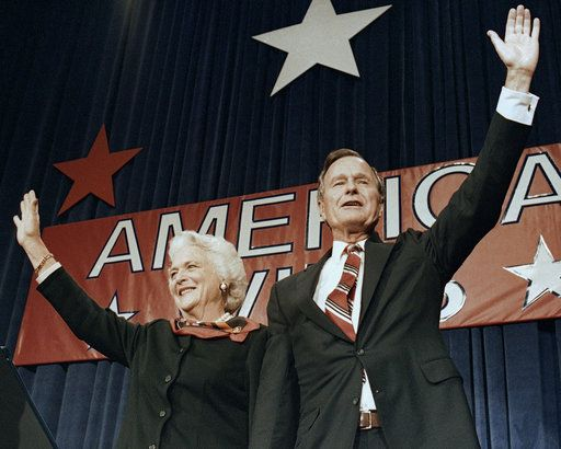 FILE - In this Nov. 8, 1988 file photo, President-elect George H.W. Bush and his wife Barbara wave to supporters in Houston, Texas after winning the presidential election. Bush has died at age 94. Family spokesman Jim McGrath says Bush died shortly after 10 p.m. Friday, Nov. 30, 2018, about eight months after the death of his wife, Barbara Bush.
