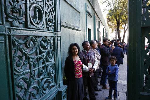Gabriela Barrientos, 71, a retired secretary, is among the first to line up at the gate to enter the presidential residence know as Los Pinos, in Mexico City, Saturday, Dec. 1, 2018. In his first day as president, Andres Manuel Lopez Obrador threw open the gates of the luxurious official residence of presidents since the 1930s and plans to keep it open for the general public as a cultural attraction and as an extension of the Chapultepec park.
